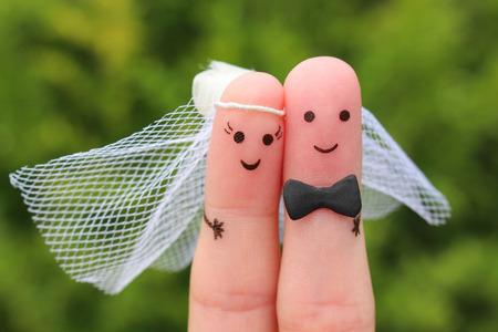 Foto de Fingers art of happy couple to get married. Concept of wedding ceremony. - Imagen libre de derechos