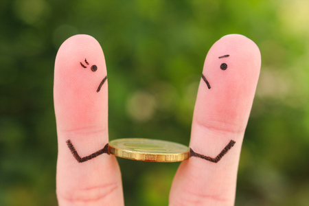 Fingers art of family during quarrel. Concept of man and woman can not divide money after divorce.