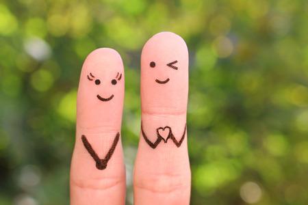 Photo pour Fingers art of happy couple. Boyfriend showing fingers in heart shape. Concept of declaration of love. - image libre de droit