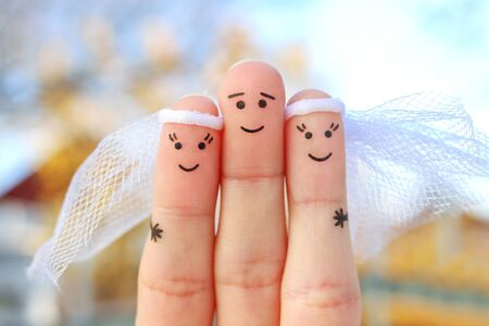 Fingers art of happy people. Plural marriage.