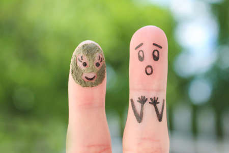 Photo for Fingers art of couple. Husband saw his wife with clay face mask and was afraid. - Royalty Free Image