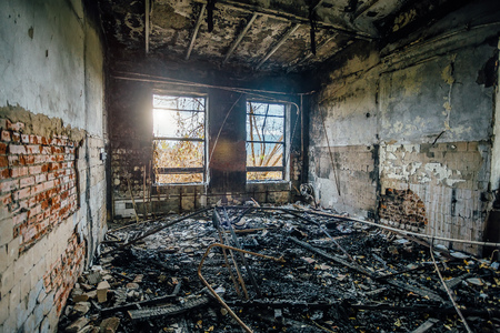 Burned interiors of industrial hall after fire in the factory