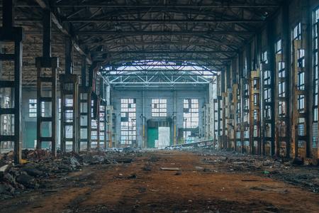 Foto de Dark ruined rotten abandoned large industrial hall. Voronezh excavator factory - Imagen libre de derechos