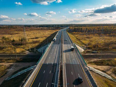 Photo pour Highway brdge above railway, drone aerial view. - image libre de droit