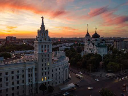Foto für Evening summer Voronezh cityscape. Annunciation Cathedral and Tower of Management of South-east railway at sunset. - Lizenzfreies Bild