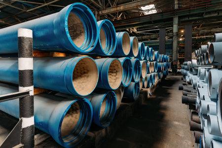 Photo pour New cast iron pipes for pipeline construction in warehouse. - image libre de droit