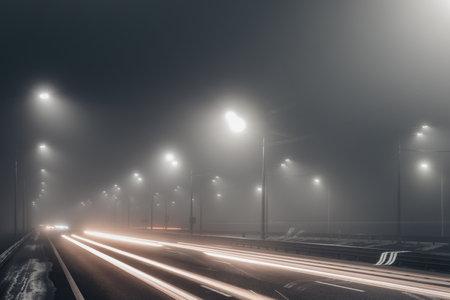 Photo pour Foggy misty night road illuminated by street lights. - image libre de droit