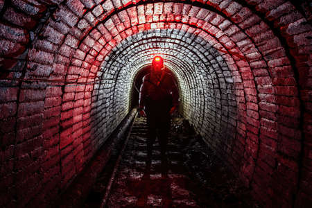 Photo for Man in protective suit inside abandoned uranium mine. - Royalty Free Image