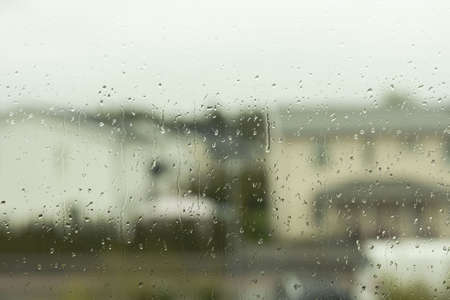 Photo for Beautiful view of raindrops running on window glass. Beautiful nature backgrounds. - Royalty Free Image