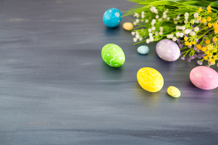 Photo pour Painted easter decoration with and flowers on a gray wooden table. - image libre de droit