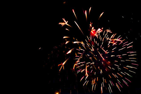 Photo for Beautiful fireworks for New Years, Independence Day or other holiday against the background of a dark sky. - Royalty Free Image