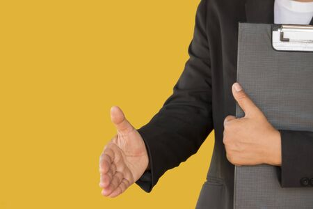 Photo for young business woman shaking hand isolated on yellow background - Royalty Free Image