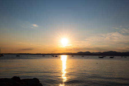 Photo pour Sunset in Bardolino on Lake Garda with mountains in the background - image libre de droit