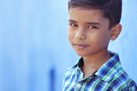 Photo pour Portrait of Indian Little boy Posing to Camera with Expression - image libre de droit