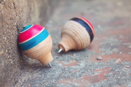 Photo pour Classic wooden spinning top toy with string - image libre de droit