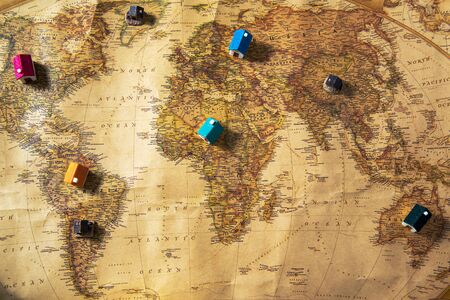 Photo pour Geographical map of the world with small houses on the continents - image libre de droit