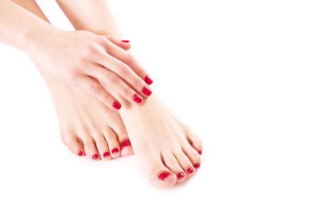 Foto de Well-groomed hands and feet on a white background close-up. - Imagen libre de derechos