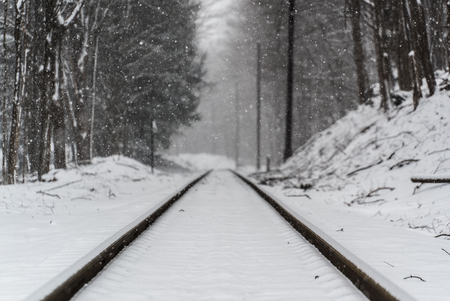 Railway tracks covered in snow. Focus on snow