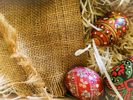 Photo for Easter eggs in straw and linen material. Special wood eggs for easter decor. - Royalty Free Image