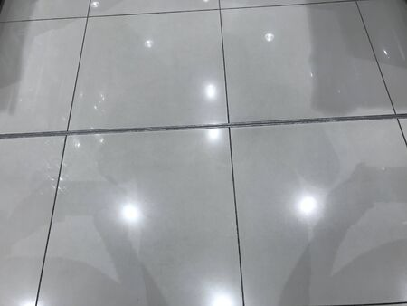 Photo for Square shaped Ceramic tile flooring with an lighting reflection in an commercial shopping mall in muscat oman - Royalty Free Image
