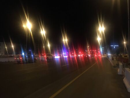 Photo pour At weekend mode going to celebrate weekend in car in urban city road with glittering street lights and downtown is awesome to get themselves rock the motion of speed cars - image libre de droit