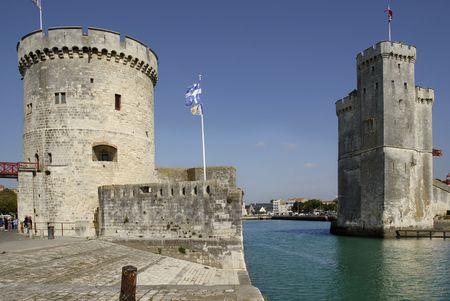 Walled entry port of La Rochelle in France,tower of the Chaine (tour de la Chaîne) on the left, tower saint Nicolas (Tour saint nicolas) on the right. Region Charente Poitou