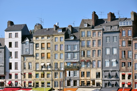 Typical facades on the port of Honfleur, commune in the Calvados department in northwestern France