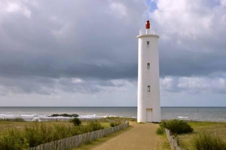 Lighthouse Grosse terre on the dunes of the coastline of Saint Gilles Croix de Vie, commune in the Vendee department in the Pays de la Loire region in western France