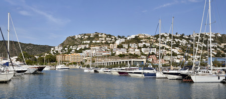 Panoramic photo of port and town of Roses, or Rosas, commune on the Costa Brava at northeastern Catalonia in Spain