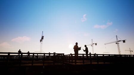 Foto de Silhouette Construction Worker Looking At Blueprints - Imagen libre de derechos