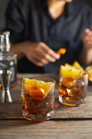 Photo pour Tasty alcoholic old fashioned cocktail with orange slice - image libre de droit