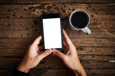 Photo pour Smartphone white screen on wooden table.Top view - image libre de droit