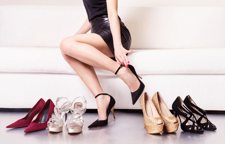 Photo for Woman trying on shoes. - Royalty Free Image