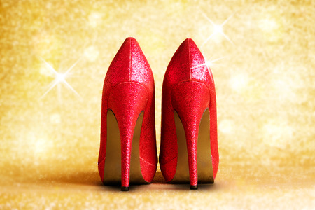 Red high heels with illumination and background.の写真素材
