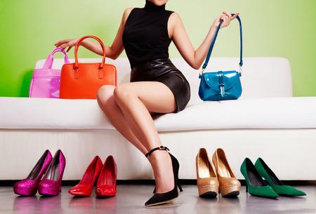Photo pour Woman shopping colorful bags and shoes. - image libre de droit