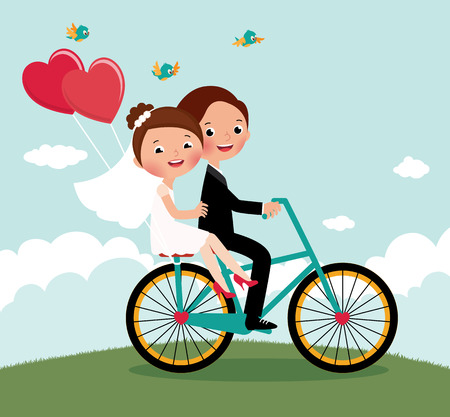 Foto de Newlyweds on a bike ride on a honeymoon - Imagen libre de derechos