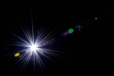Photo pour Abstracts lights, Sun shine flash lens effect or star spot glow light on black background. Gleams rounded and hexagonal shapes, rainbow halo - image libre de droit