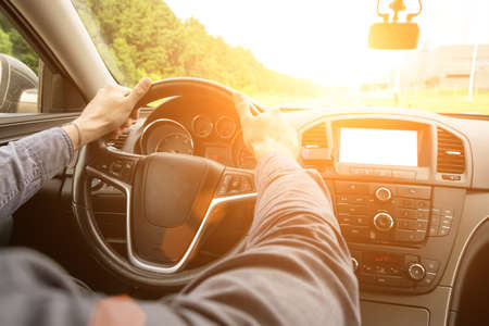 Foto per Road trip. Happy young man have fun travel inside car at sunset. Summer vacation concept with driver - Immagine Royalty Free