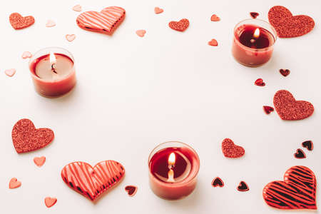 Photo pour Valentines day minimal: red love hearts, romantic gift box, candle on white background. Sainte Valentine, mothers day, birthday greeting cards, invitation, celebration concept - image libre de droit