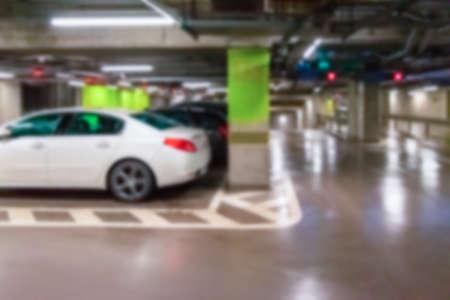 Photo for Parking garage blurred. Empty road asphalt background in soft focus. Car lot parking space in underground city garage. Modern underground parking - Royalty Free Image