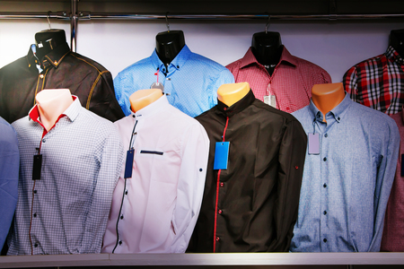 Advertising  for shop  men's clothing. Showcase with men's shirts on mannequins