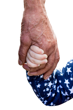 Photo pour The hand of an old man and the hand of a little girl on a white isolated background. Unity of generations. Old age and youth. Grandfather and his granddaughter - image libre de droit