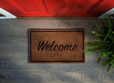Foto de Overhead view of welcome mat outside inviting front door of house with potted fern plant - Imagen libre de derechos