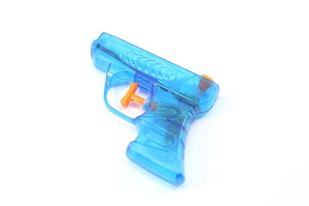 Blue plastic toy squirt gun photographed on a white background