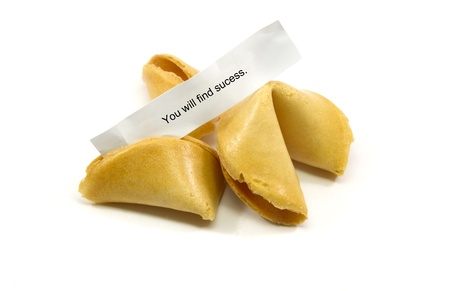 Chinese fortune cookies cracked open with the fortune You will find success.