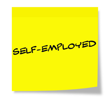 Self-Employed written on a paper yellow Sticky Note making a great concept.