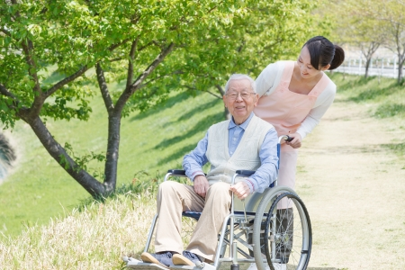 Japanese caregivers and senior smile in the fieldの写真素材