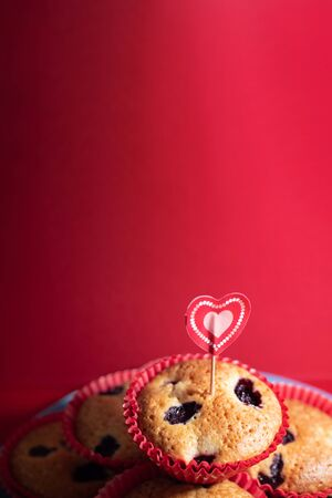Photo for Muffins with blueberries and raspberries. Cupcakes with Valentine's Day decor. Flat lay. Banner. - Royalty Free Image