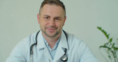 Portrait of confident doctor in private clinic. Medicine, healthcare and medical professionals concept.