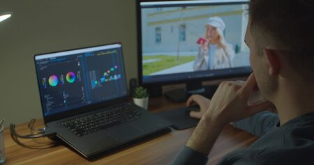 Photo for Man working on computer with Two Monitors Color Correction Post Production video or photo in Progress Closeup - Royalty Free Image